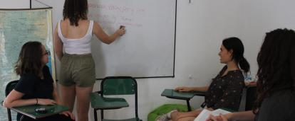 A small group of volunteers in Argentina learn and practice Spanish together.